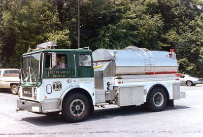 Tanker 1 was a 1980 Mack CF/4-Guys, 350/2000.  Totaled in 1994 during accident.