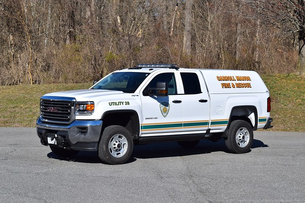 Utility 28 is a 2018 GMC Sierra 2500 with an ARE cap.