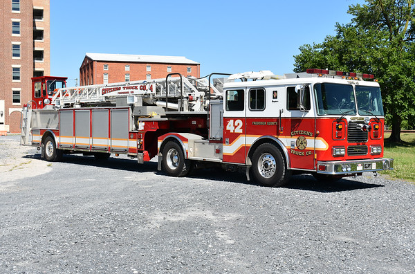 Officer side view of Truck 42 from Citizens Truck Company in Frederick, Maryland.  2001 Seagrave 100'.