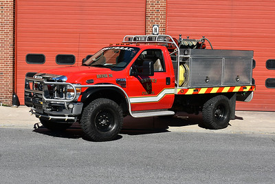 Not much room to photograph a fire/rescue vehicle on the ramp of United FC in Frederick, Maryland.  Brush 35 just barely fit.  The brush truck is a 2008 Ford F350 4x4/Firematic Brat equipped with a 120/200/8.  Photographed in July of 2017.