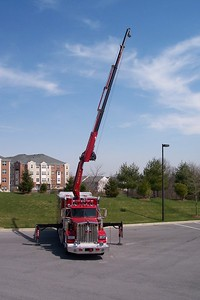 Clarksville's Rescue 5 with crane in operation.