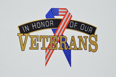 """""""In Honor Of Our Veterans"""" adorns the side of Tower 2."""