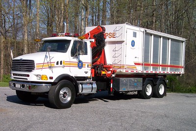 Transport 10 is this 2003 Sterling/Burch pod unit equipped with a 55' Palfinger Crane.