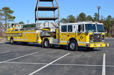 An officer side view of Truck 3 from Bay District VFD in Lexington Park, Maryland.  Truck 3 is a 2008 Seagrave Marauder II TT05DA 100' tiller.  Serial number 76384.