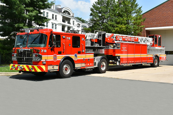 Montgomery County, Maryland's Truck 710 is assigned to the Cabin John Park Station.  Truck 710 is a 2016 Spartan ERV Gladiator 100' tiller with serial number 3215045-02.  It is one of three delivered to Montgomery County, the other two assigned to T-725 in Kensington and T-731 in Rockville.  The new Truck 710 replaced a 2005 Pierce Arrow XT 100' tiller painted white with a blue stripe - reassigned to reserve.