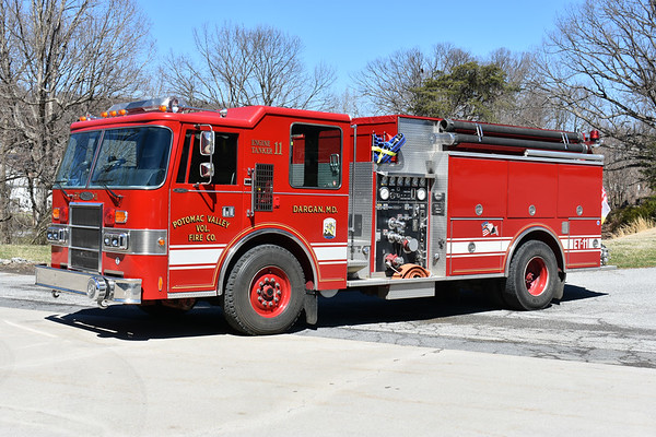 Engine - Tanker 11 from Potomac Valley is a 1992 Pierce Dash 1000/1800 and job number E6794.  Note the rear cab doors for entry into the jump seats.