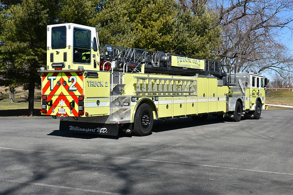 Williamsport, Maryland Truck 2 in Washington County.  A 2019 Pierce Arrow XT with a 1996 LTI trailer.  100' tiller and Pierce job number 31941.  Originally delivered to Encinitas, CA where it was painted lg/w with blue stripes and had a 1996 Simon-Duplex as well as a 1500/300.  It ultimately ended up with Morningside, Maryland who planned on placing the truck into service.  Problems prevented that and Williamsport had the truck repainted to their lg/w colors and delivered as Truck 2.  Williamsport did make some modifications to the trailer, including the modified body to accomodate ladders.  Photographed in March of 2020 prior to Truck 2 being placed into service.
