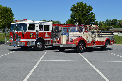 The old and the current from Engine 5 in Hagerstown - 2003 KME on the left and a 1952 Mack 85LS on the right.  Photographed in August of 2016.