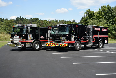 Group photo taken in August of 2019 of Engine - Rescue 1-7-1 (right) and 1-7-2 (left).