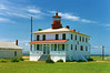 In May 1828 Congress appropriated an additional $4,500 and tendered a contract with the infamous Maryland lighthouse builder, John Donahoo, to build the Point Lookout Lighthouse.  Donahoo was paid $3,350 to build a whitewashed single story brick keepers house with a red shingled roof with a protruding black lantern.