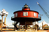 The Light House Board rejected the first plan submitted to build a 60 foot brick tower on a screwpile foundation with a 3rd Order Fresnel lens.  They developed a new plan which called for a 40 foot cast iron tower with a 4th Order lens.  The Baltimore iron Foundry of Murray and Hazelhurst was awarded the contract to build the lighthouse.  Construction began in 1854 and was completed late in 1855.