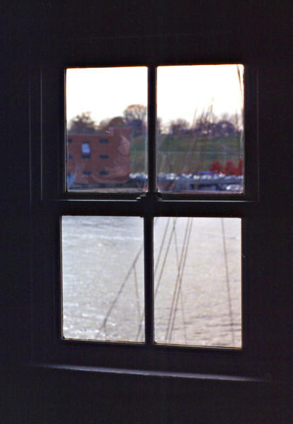 **View out of a second floor window**<br /> In 1884 the lighthouse suffered damage when one of the supporting iron piles was broken by ice.  To address this, wooden piles were driven into the mud around the lighthouse and secured with iron cables.  Ten years later a diver checking the foundation reported all 150 wooden piles had 'disappeared'.  Afterwards 790 cubic yards of rip rap was placed along the base of the piles to prevent further damage.  Additional rip rap was placed around the foundation in 1897 and 1903.