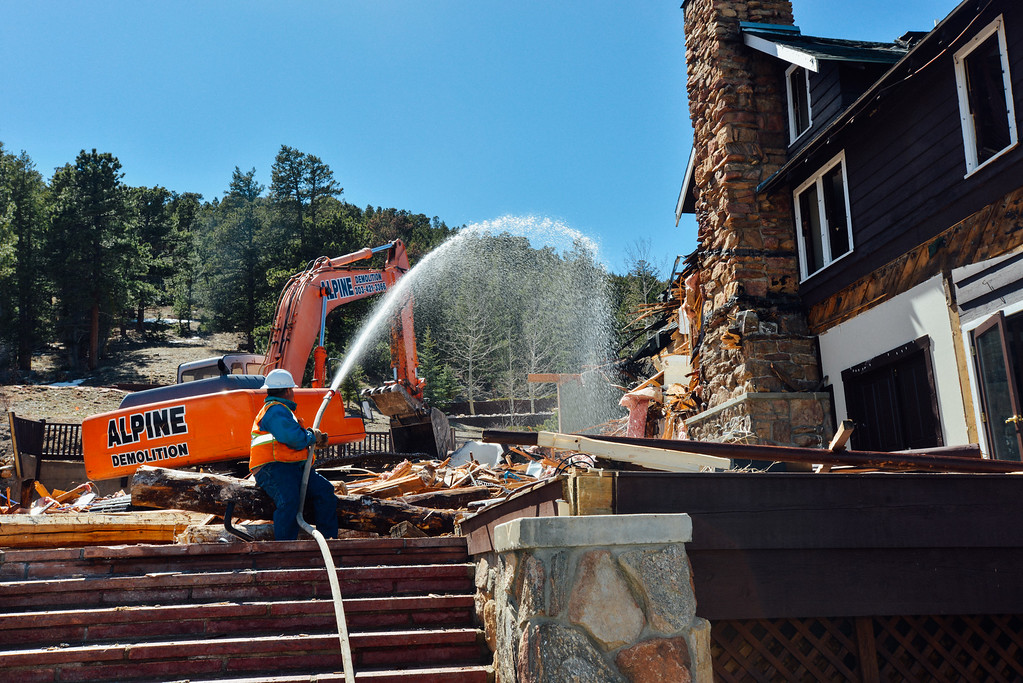 . Workers begin the demolition process at Mary�s Lake Lodge in Estes Park, CO on Thursday April 18th, 2019 following a fire that destroyed part of the structure in June 2018. (Bob Wooley/Trail-Gazette)