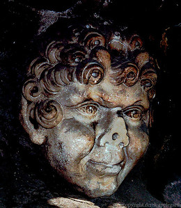 A sculpted face - one of four statueswithin four fountains at a town square in Palermo,  Sicily.