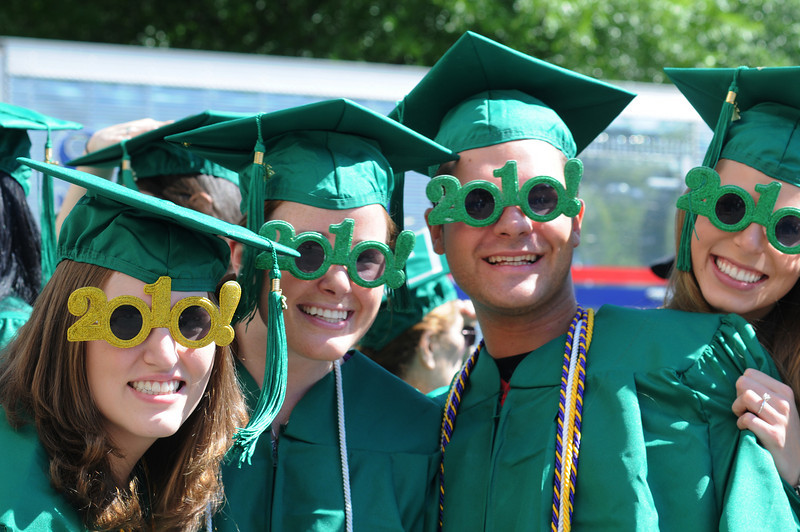 Mason graduates don celebratory eye wear—in the appropriate green and gold—outside the Patriot Center on the Fairfax Campus where Commencement was held. The 2010 graduating class consisted of 4,381 Bachelor's, 2,972 Master's, 240 Doctoral, and 202 Law students. Photo by Lori Wilson
