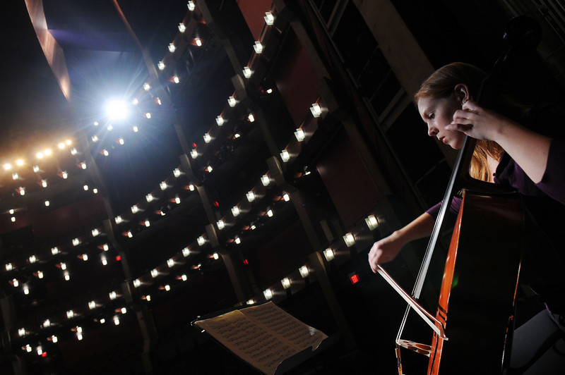 A cellist performs on stage at the Hylton Performing Arts Center on the Prince William Campus. Photo by Evan Cantwell