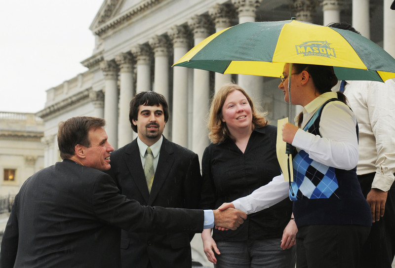 Virginia Sen. Mark Warner greets Mason students Minerva Venuti and Tarek A. Lahlou, and Mason professors Jill Nelson and Padmanabhan Seshaiyer at the Posters on the Hill event. The group also met with Virginia Reps. Gerry Connolly and Frank Wolf, among others. Photo by Evan Cantwell