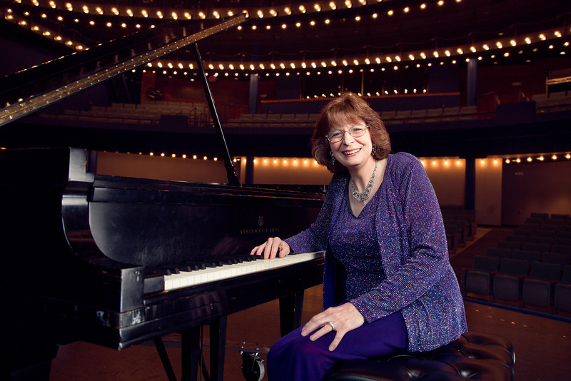 School of Music professor Linda Apple Monson poses at the piano.  Will Martinez/Creative Services/George Mason University