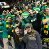 Students cheer during the men's basketball  game against VCU at the Patriot Center on George Mason University Fairfax Campus. Photo By Craig Bisacre/Creative Services/George Mason University