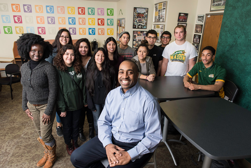 Associate Dean for University Life, Lewis Forrest II, poses with students at the Early Identification Program offices.  Photo by:  Ron Aira/Creative Services/George Mason University