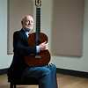 "Larry Snitzler, 71, who has taught classical guitar at George Mason University for 41 years as an adjunct professor, is retiring at the end of this semester. He and his wife, Soledad, will live in her native, Santiago, Chile, where he will complete his book on Spanish composer Joaquim Malats, write music and continue playing in the United States and Europe. Said Linda Monson, managing director of George Mason's School of Music: ""He will be deeply missed.""  Photo by:  Ron Aira/Creative Services/George Mason University"