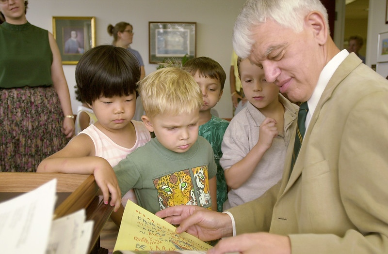 Alan Merten reads to children from the Child Development Center. Photo by Evan Cantwell