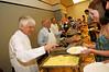 Dr. Merten helps serve breakfast at the 2006 Senior Brunch. Photo by Evan Cantwell
