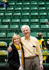 Dr. Alan Merten and his wife Sally attend the Mason Homecoming 2012 basketball game at the Patriot Center, Fairfax Campus. Photo by Alexis Glenn/Creative Services/George Mason University