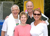 The Mertens and the Larranagas in front of the dunk tank during Welcome Week. Photo by Evan Cantwell