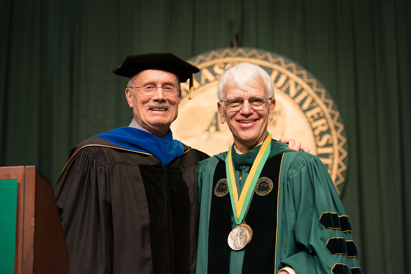 Ernst Volgenau presents the Mason Medal to Alan Merten at Commencement 2012. Photo by Alexis Glenn/Creative Services/George Mason University