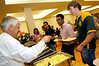 Dr. Merten helps serve breakfast at the 2006 Senior Brunch. Photo by Evan Cantwell