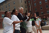President Alan Merten poses with students at the ribbon cutting for Shenandoah residence hall. Photo by Evan Cantwell.