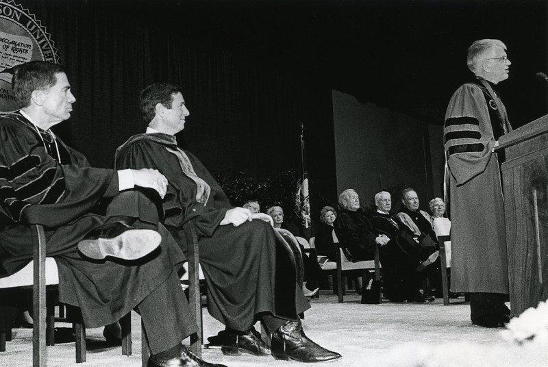 Senator Robb and Governor Allen look on as President Alan Merten gives his inauguration address.