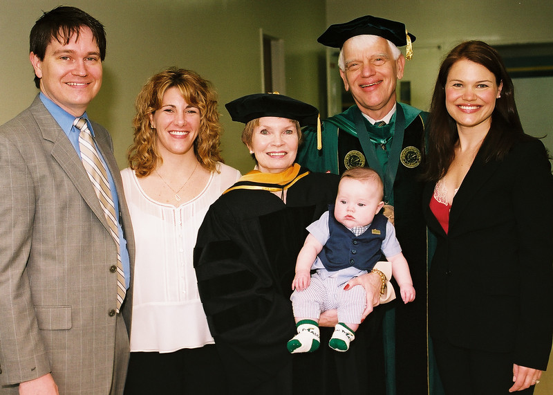 President Alan Merten and wife Sally with their son Eric, his wife Kristin (on left), daughter Melissa and first grandson Ryan (born December 2004, son of Eric & Kristin).