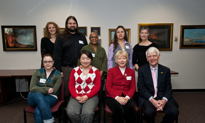 Dr. Alan Merten poses with eight of the 2011 Employees of the Month at a ceremony honoring each Employee of the Month from 2011 in Mason Hall at Fairfax Campus. Photo by Alexis Glenn/Creative Services/George Mason University