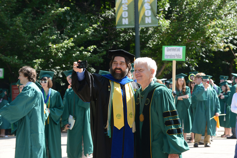Associate Professor Tom Wood posing for the camera with Alan Merten at Commencement 2012. Photo by Evan Cantwell/Creative Services/George Mason University