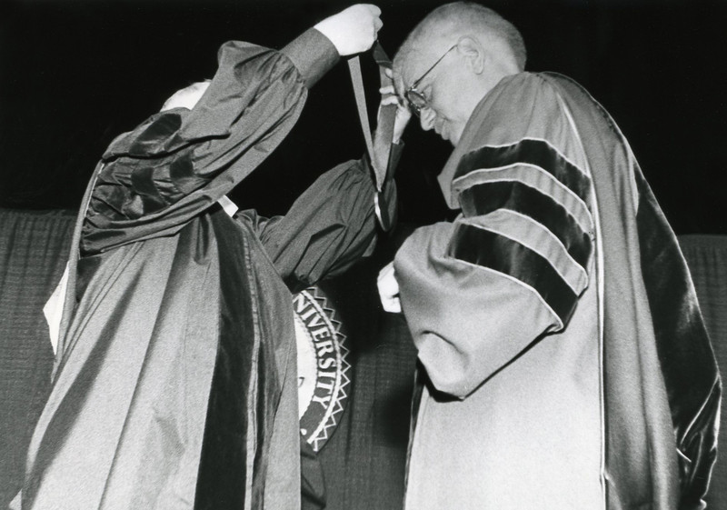 President Alan Merten  receiving the inauguration medal.