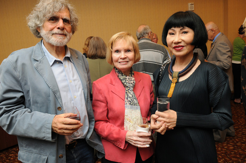 Alan Cheuse, Sally Merten and Amy Tan at a 2011 Fall for the Book reception. Photo by Evan Cantwell