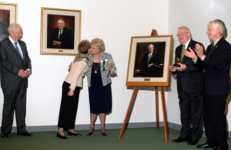 From left: Sidney Dewberry, Sally Merten, Ursula Meese, Edwin Meese and President Alan Merten during the unveiling of Edwin Meese's portrait at his final Board of Visitors meeting. Photo by Evan Cantwell.