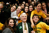 President Alan Merten poses with students during a 2006 Final Four pep rally. Photo by Joe Milmoe.