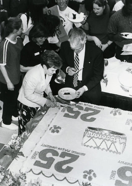 President Alan Merten and wife Sally at Mason's 25th anniversary celebration in 1997.