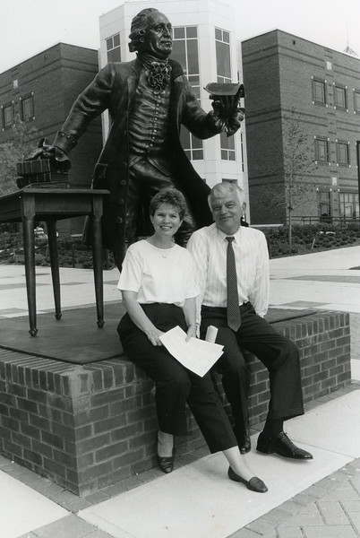 President Alan Merten and wife Sally at the Mason statue.