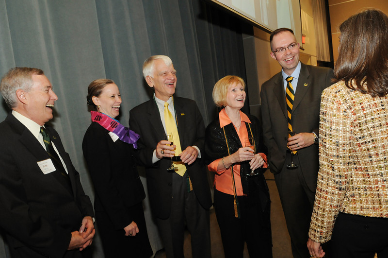 Alumni Weekend 2011 - Mason President Alan Merten and Sally Merten were honored with a champagne toast during Alumni Weekend. Joining them, from left, are past Alumni Association presidents Peter Farrell, Catherine Lemmon and Ted Arnn, as well as Christine Clark-Talley, associate vice president for alumni affairs. Photo by Evan Cantwell