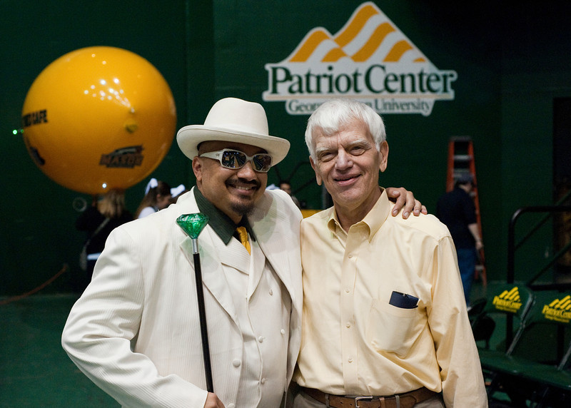 Doc Nix, Director of the Green Machine, and Dr. Alan Merten attend the Mason Homecoming 2012 basketball game at the Patriot Center, Fairfax Campus. Photo by Alexis Glenn/Creative Services/George Mason University
