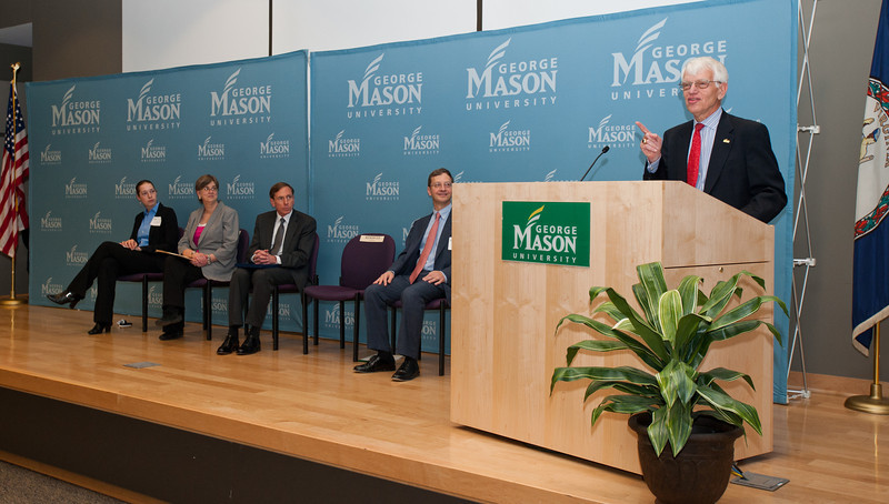 Mason President Dr. Alan Merten speaks at the dedication of Founders Hall on the Arlington Campus of George Mason University in Arlington, Virginia on March 8, 2012. Listening (L to R) are Student speaker Jacqueline Antonson, Arlington County Board Member Mary Hughes Hynes, Director of the Central Intelligence Agency General David H. Petraeus, and Ed Rhodes, Dean of the School of Public Policy. Photo by Alexis Glenn/Creative Services/George Mason University
