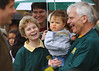 Celebrating the Men's basketball team road to the Final Four Sally and Alan Merten with grandson (2006). Photo by Evan Cantwell