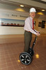 President Merten on a Segwey in Mason Hall atrium. Photo by Evan Cantwell.