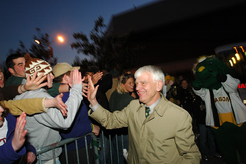 Dr. Merten greets students during the Sweet 16 send-off rally at the start of 2006 NCAA tournament. Photo by Evan Cantwell