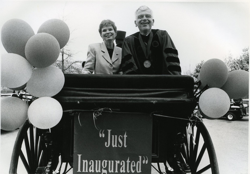 "President Alan Merten and wife Sally take a carriage tour of campus during inaugural festivities.  ""Just Inaugurated"""