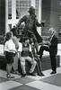 President Alan Merten speaks to students at the Mason Statue.